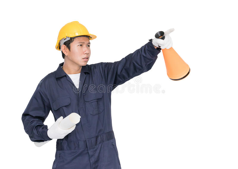 Young worker shouting for announce through a megaphone. Young worker with yellow helmet shouting for announce through a megaphone loud hailer isolated over white royalty free stock images