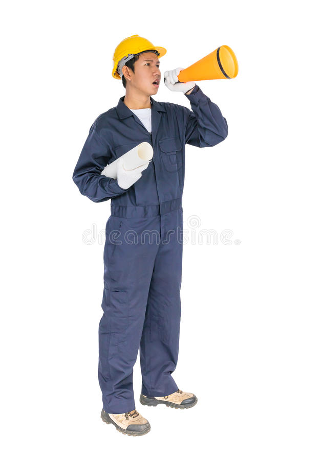 Young worker shouting for announce through a megaphone. Young worker with yellow helmet shouting for announce through a megaphone loud hailer isolated over white stock photos