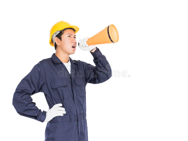 Young worker shouting for announce through a megaphone. Young worker with yellow helmet shouting for announce through a megaphone loud hailer isolated over white stock image
