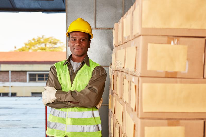 Young worker in the specialized warehouse is training stock photo
