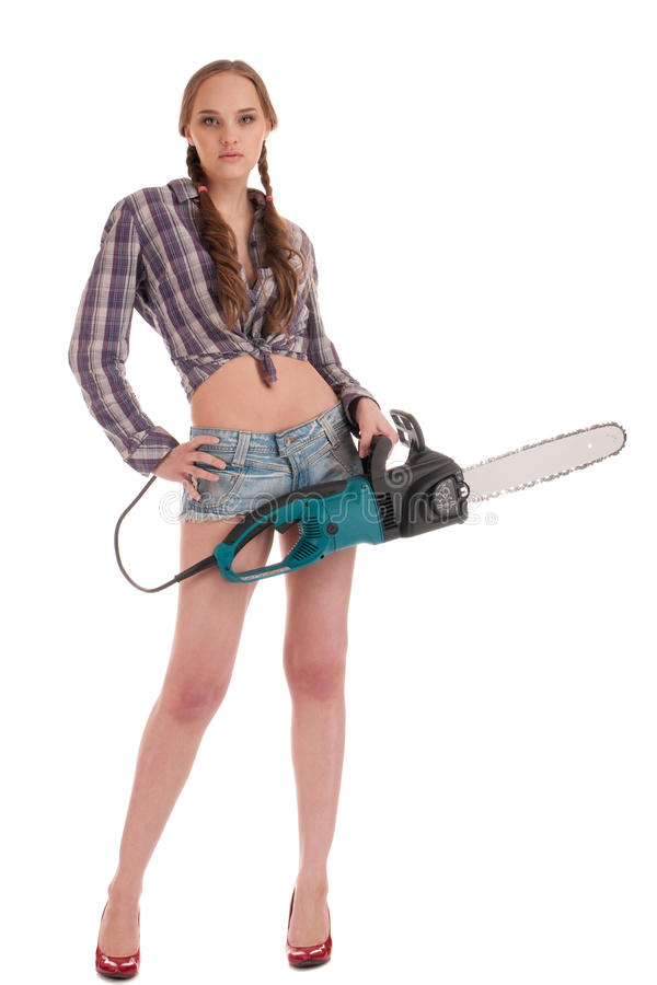 Young worker woman with chain saw royalty free stock photo