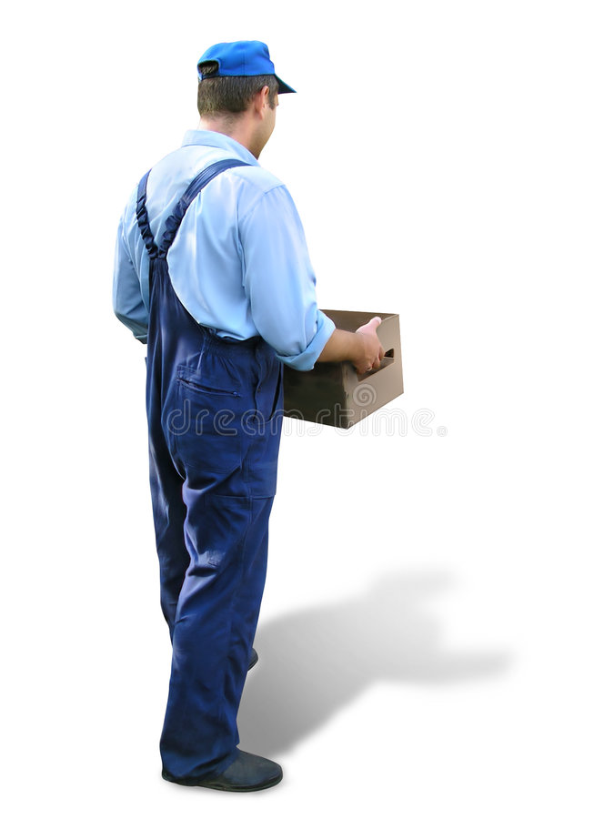 Young worker in working clothes, carrying a box. Looked from behind stock images