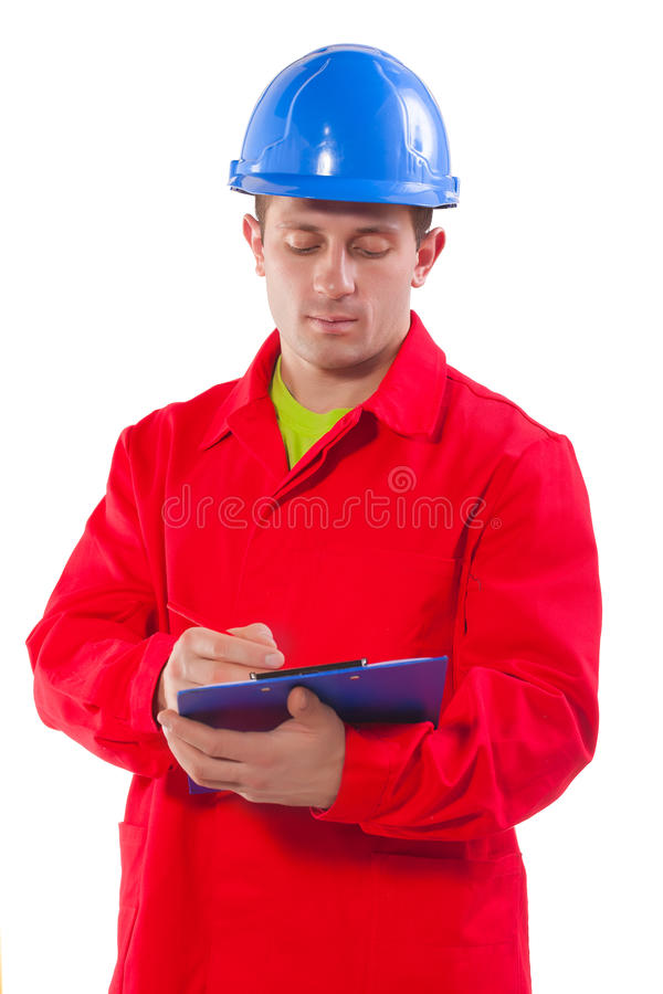 Young worker writing in clipboard stock photography