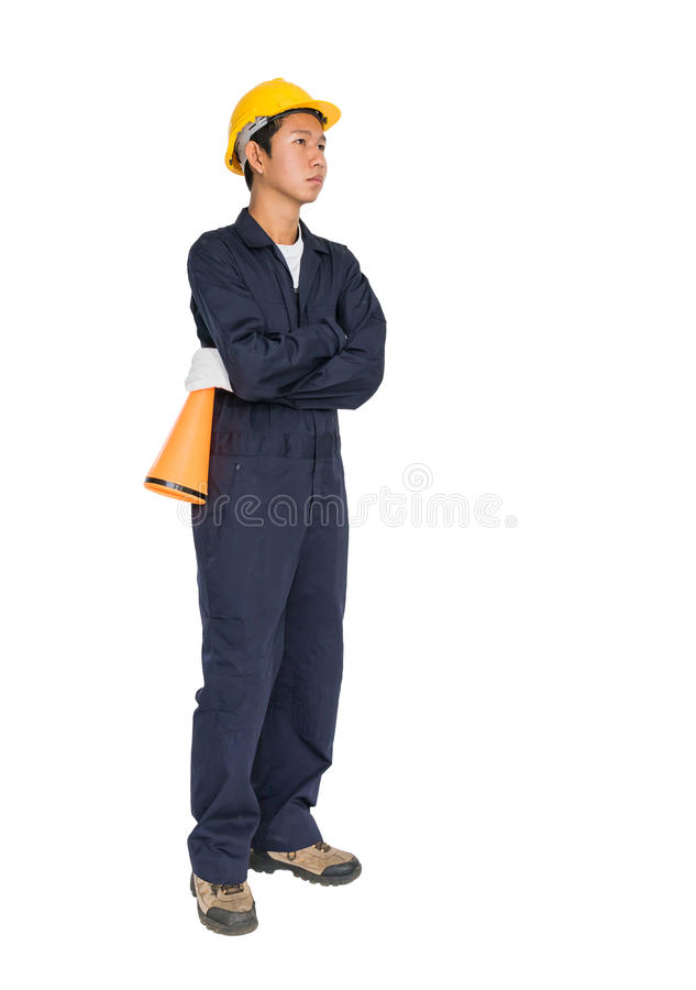 Young worker with yellow helmet holding a megaphone. Loud hailer isolated over white background stock image