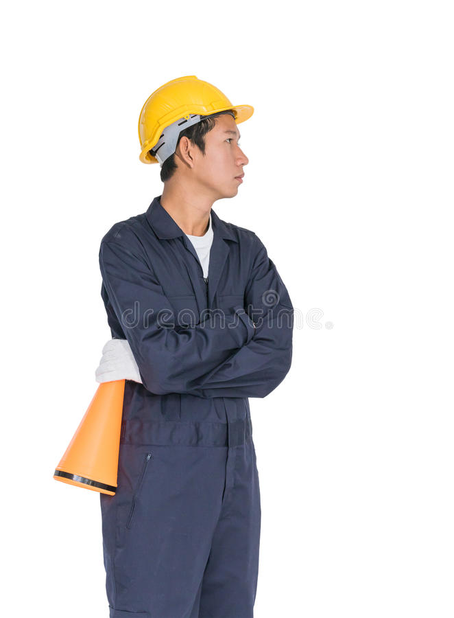 Young worker with yellow helmet holding a megaphone. Loud hailer isolated over white background stock photography