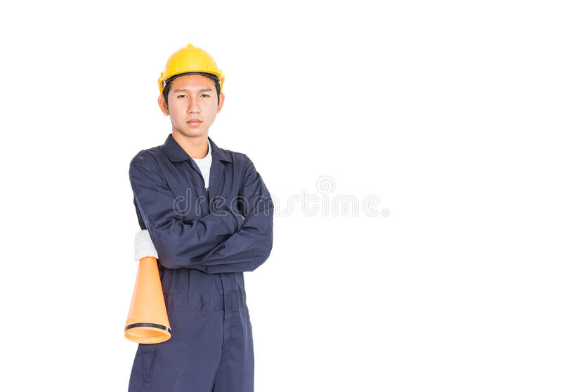 Young worker with yellow helmet holding a megaphone. Loud hailer isolated over white background royalty free stock images