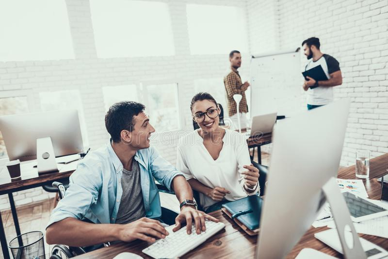 Young Workers Have Conversation in Modern Office. royalty free stock images