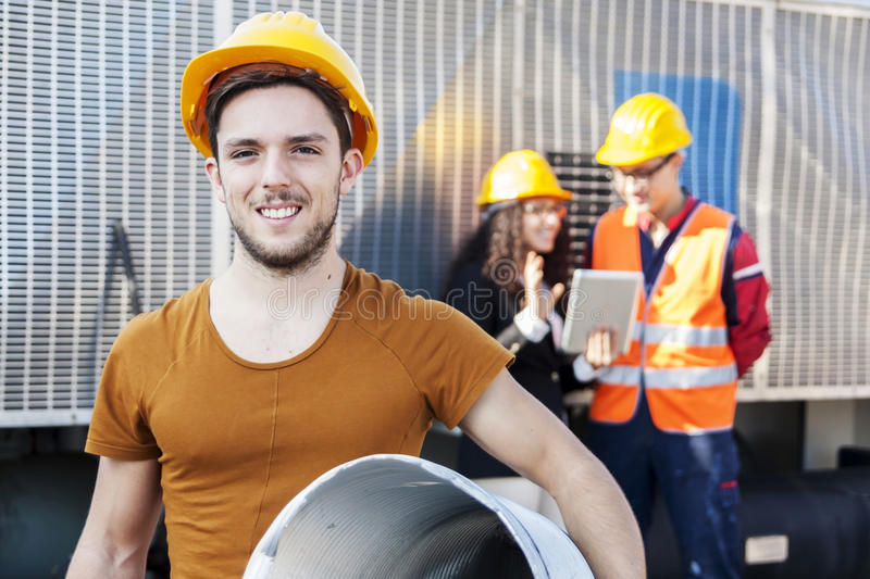 Young workers in a junkyard royalty free stock images