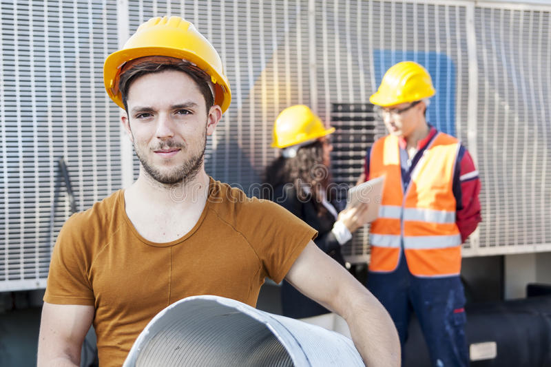 Young workers in a junkyard. Discuss about new projects stock photos