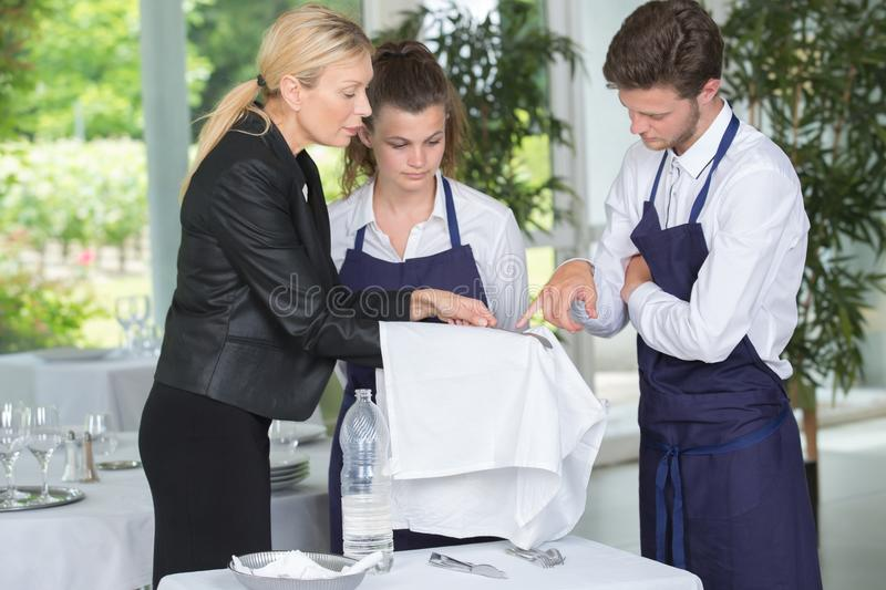 Young workers servicing food in cafeteria. Students royalty free stock photography
