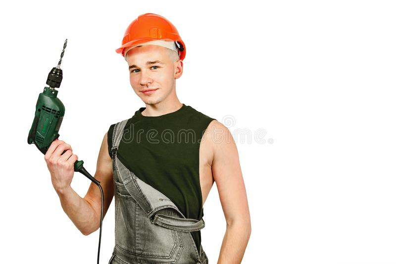 Young working guy in hard hat holds drill isolated on a white background stock photography