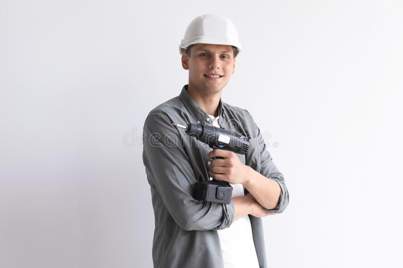 Young working man with electric screwdriver on white royalty free stock photos