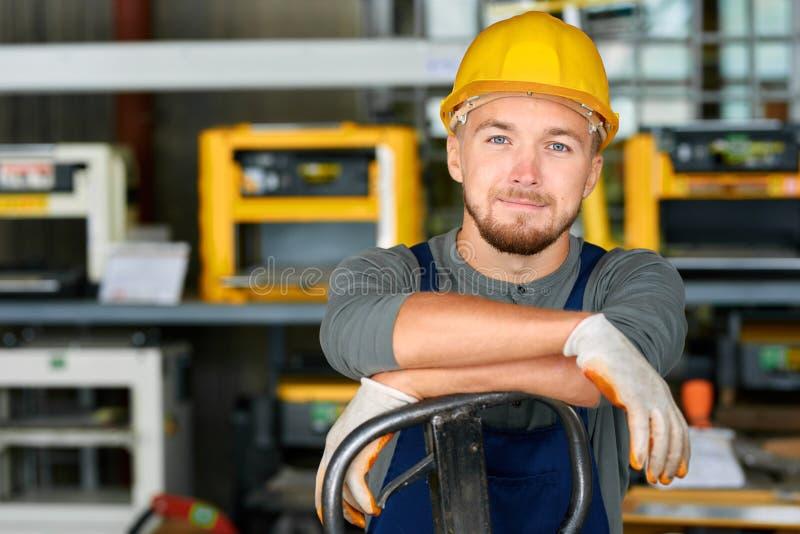 Young Workman Smiling at Camera royalty free stock photos