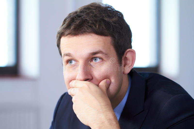 Young worried and stressed businessman royalty free stock photo