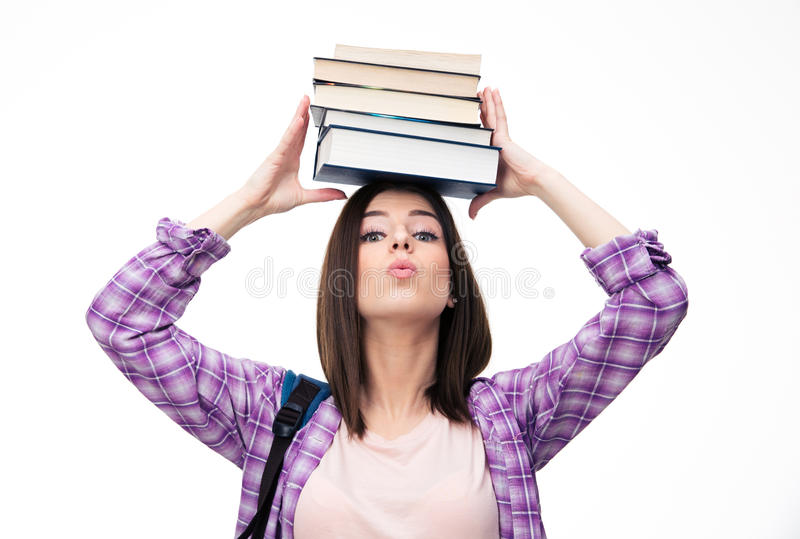 Young wowan holding books on head. Over white background and looking at camera stock images