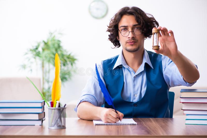 Young writer working on his new work stock photography