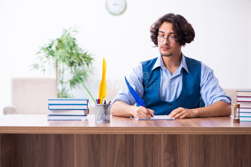 Young writer working on his new work royalty free stock image