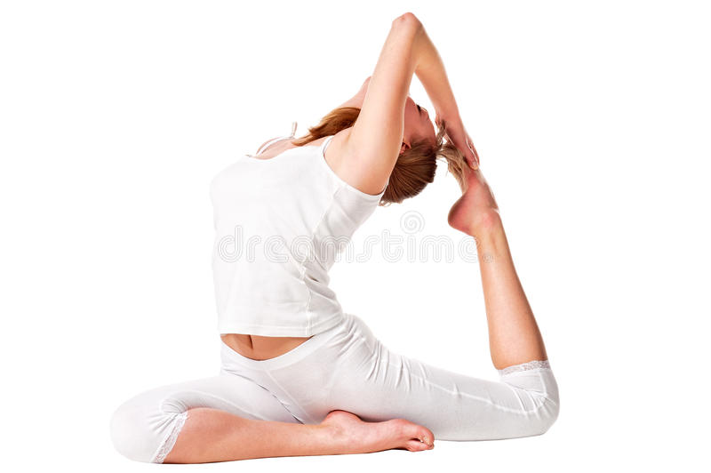 Young yoga female doing yogatic exericis royalty free stock images