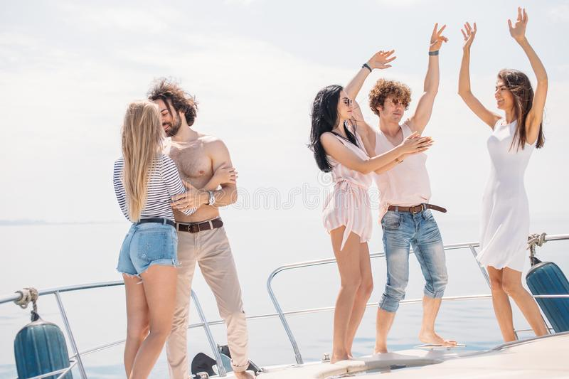 Young happy caucasian people dancing in boat party stock photography