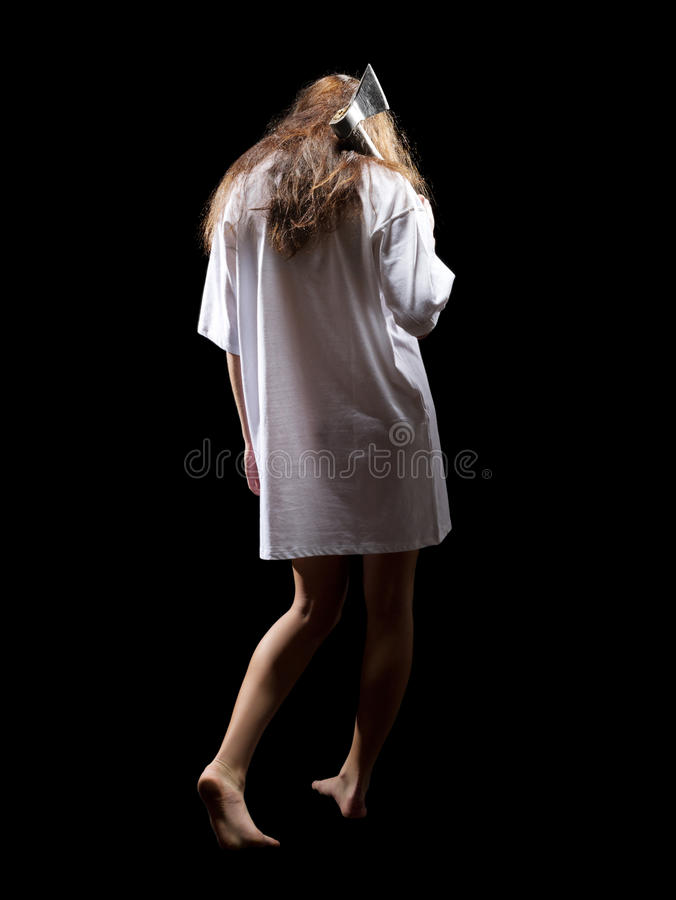 Young zombie girl with axe royalty free stock photo