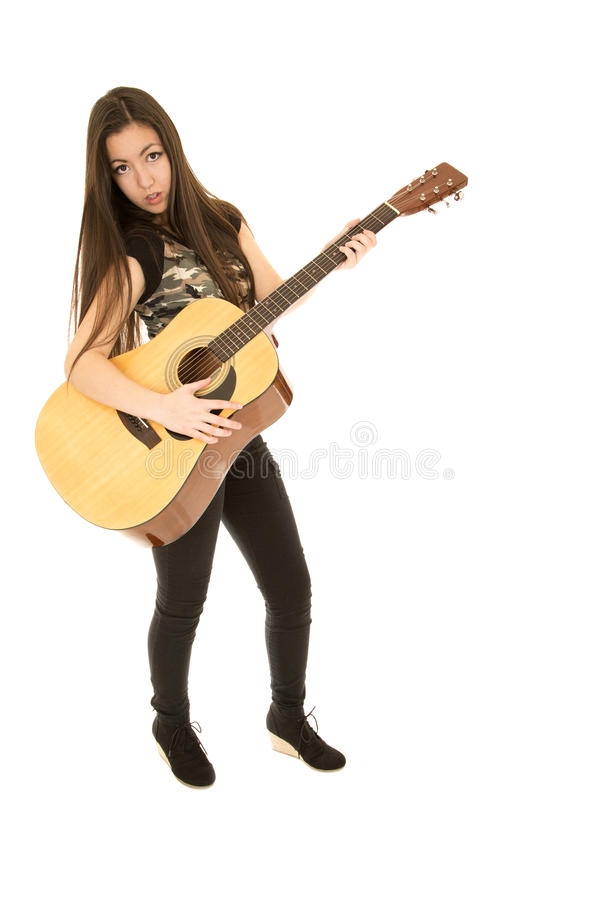 Download Younger Female Model Standing Playing Her Acoustic Guitar Stock Photo