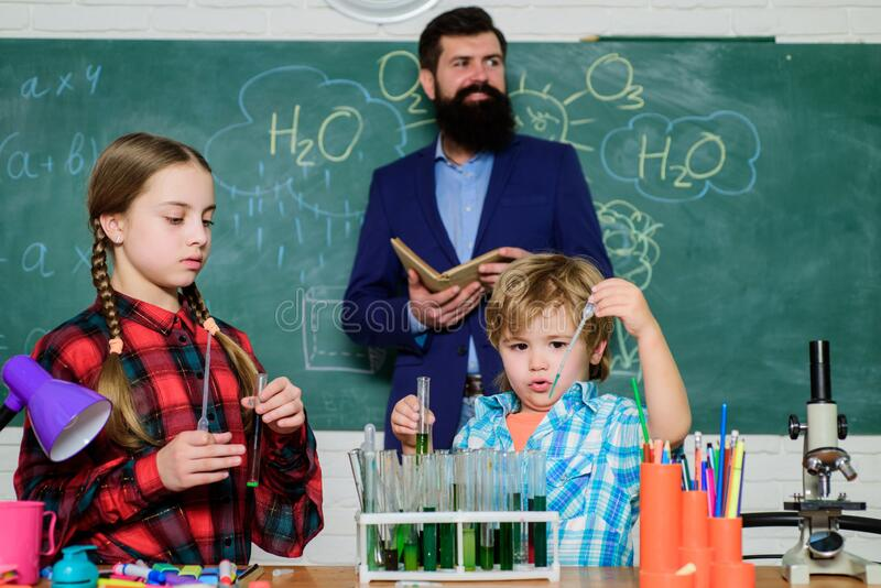 Younger learn from older. With experience comes knowledge. Formal education. Group interaction communication. Teaching. Kids sharing important knowledge royalty free stock photo