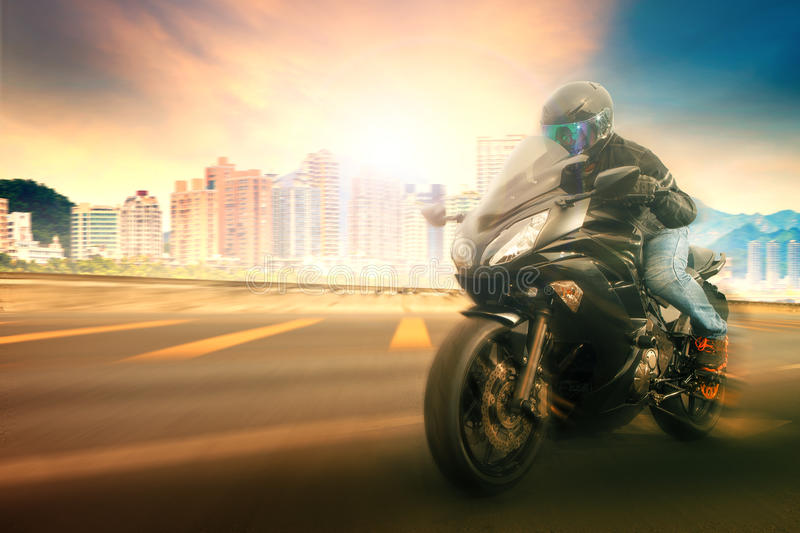 Younger man wearing safety helmet and riding suit biking sport royalty free stock image