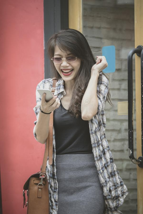 Younger woman happiness emotion reading message on smartphone stock photography