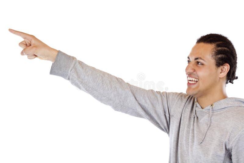 Youngman se dirigeant avec le doigt du bras NAD à l'espace d'annonce photos libres de droits