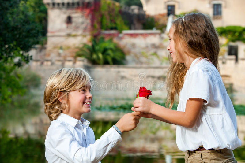 Youngster declaring love to girlfriend. Close up portrait of young boy declaring love to girlfriend at lake stock photos