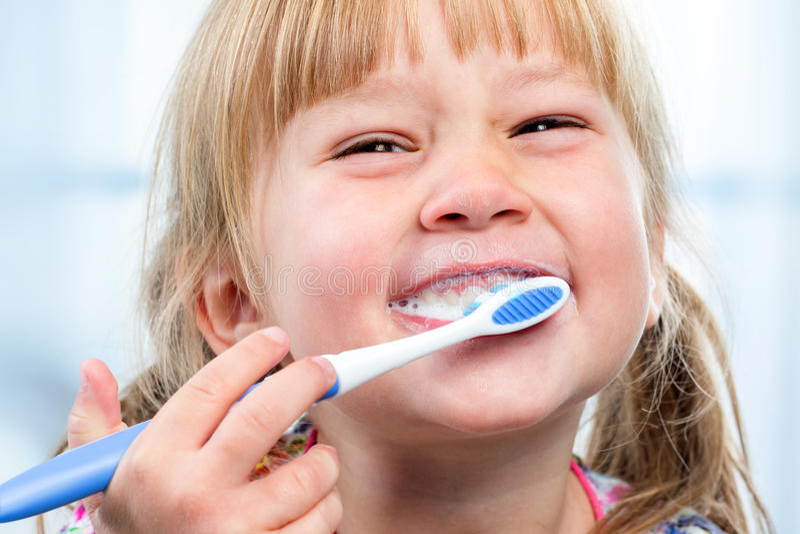 Youngster having fun brushing teeth. royalty free stock photo