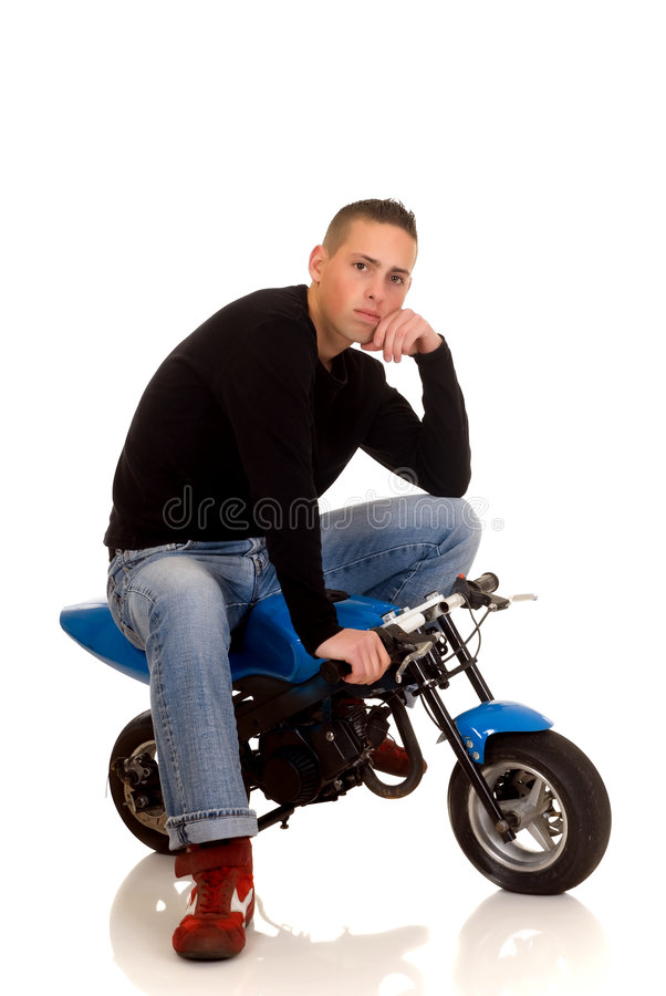 Youngster with his pocketbike stock image