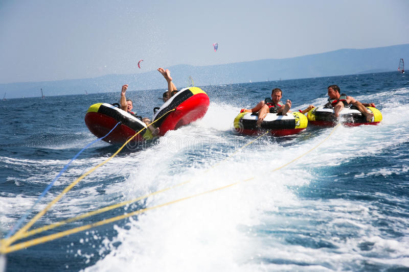 Youngsters tubing stock photos