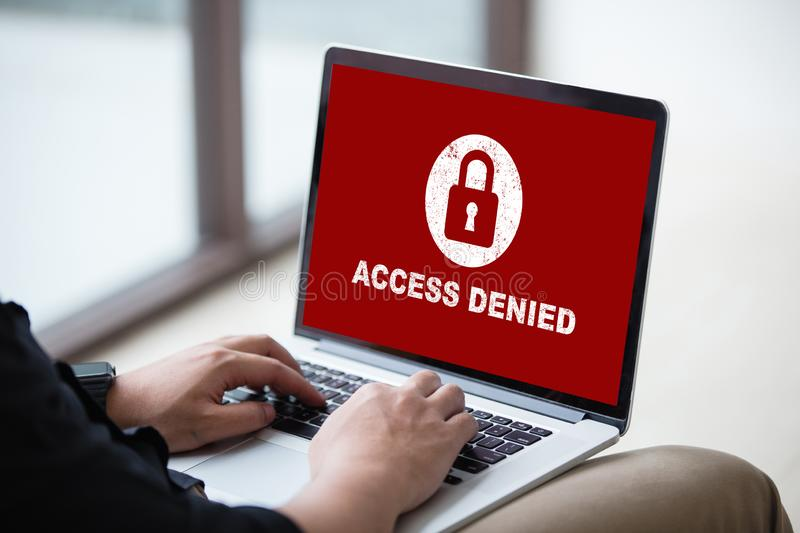 Your access is denied on laptop screen concept, protection security system. Protection security system concept. Man working on laptop with access denied text on stock photography
