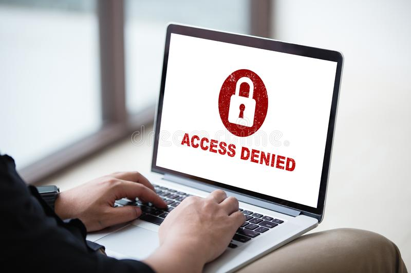 Your access is denied on laptop screen concept, protection security system. Protection security system concept. Man working on laptop with access denied text on royalty free stock image