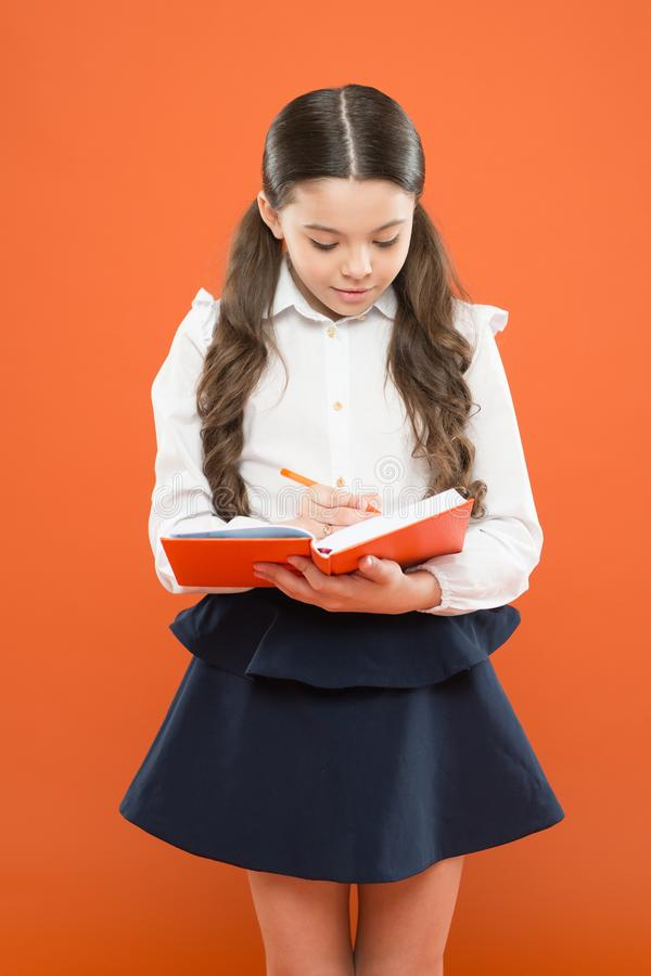 Your career path begins here. Write essay or notes. Inspiration for study. Back to school. Knowledge day. Schoolgirl. Enjoy study. Kid school uniform hold stock photography