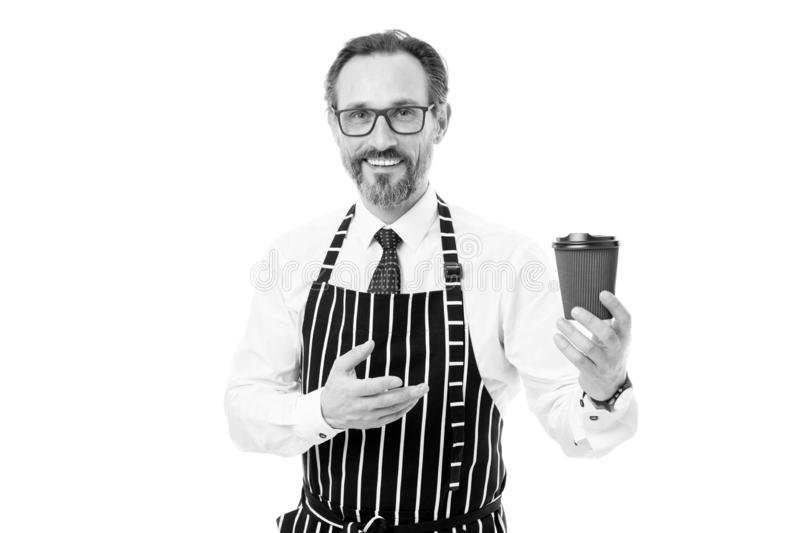 Your coffee to go. Bearded man barista hold paper coffee cup. Barista in apron served coffee. Coffee shop concept royalty free stock images