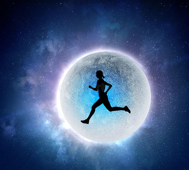 Your endless energy and motivation. Silhouette of athlete woman running on Earth planet. Elements of this image are furnished by NASA royalty free stock photography