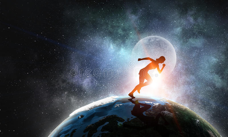 Your endless energy and motivation. Silhouette of athlete woman running on Earth planet. Elements of this image are furnished by NASA royalty free stock images