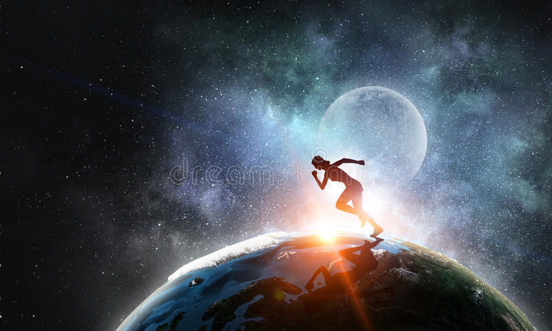 Your endless energy and motivation. Silhouette of athlete woman running on Earth planet. Elements of this image are furnished by NASA royalty free stock photos