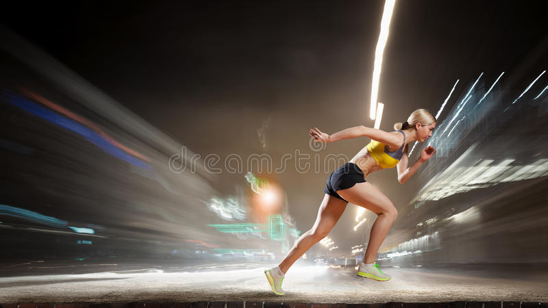 Your endless energy. Slim attractive sportswoman running fast. Mixed media royalty free stock images