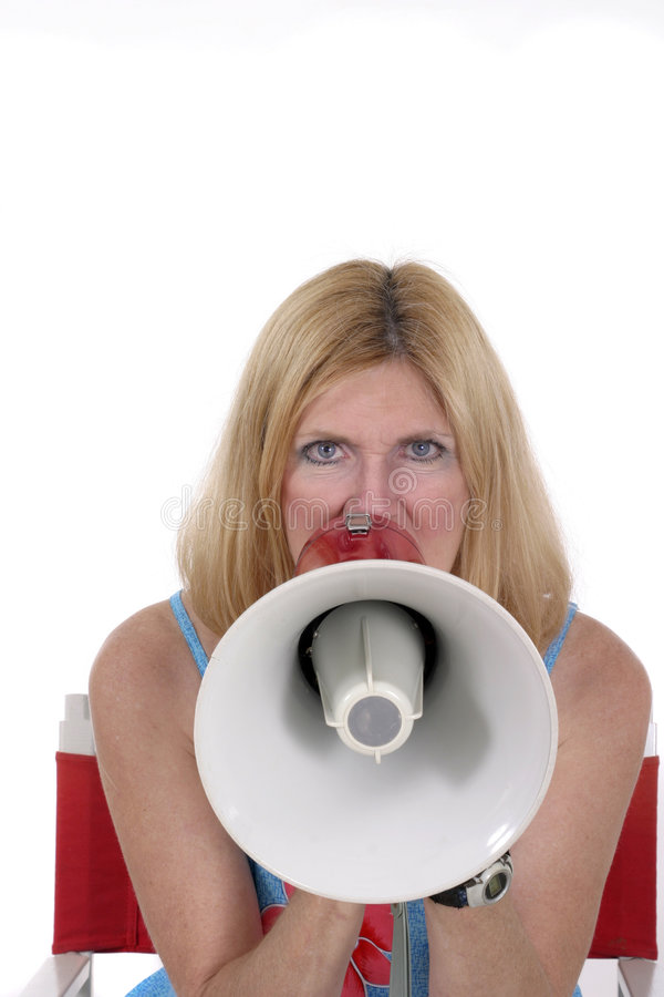 In Your Face 2. Close-up of a beautiful woman shouting through a megaphone. Shot isolated on white. If at all possible, please let me know where I can see my royalty free stock image