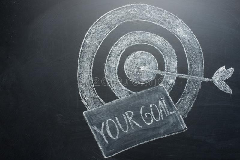 your goal is an inscription with a target on the board. The concept of winning in business and achieving the goal stock photo