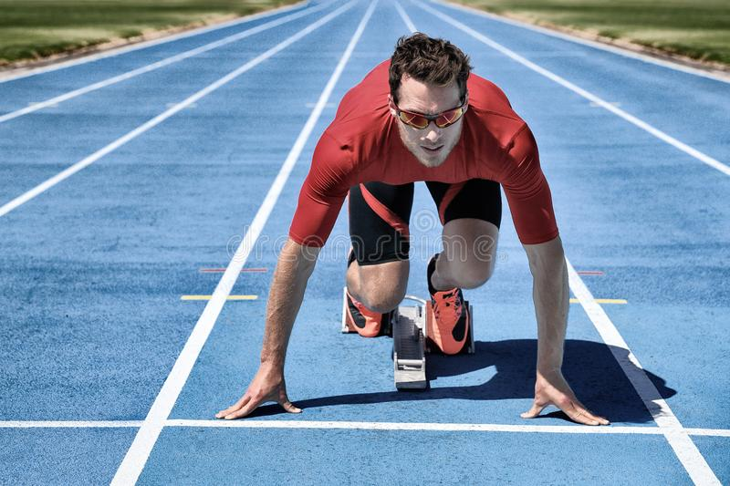 On your mark, get set, go! Running sport concept athlete ready for run competition at starting line. Sprinter man on running royalty free stock image