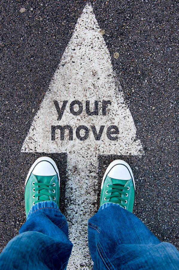 Your move sign. Green shoes standing on your move sign royalty free stock photos