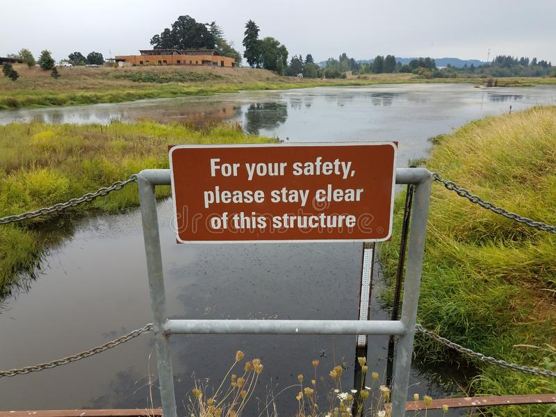 For your safety please stay clear of this structure sign royalty free stock photos