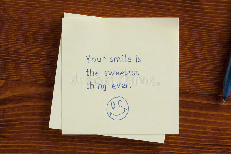 Your smile is the sweetest thing ever written on note royalty free stock images