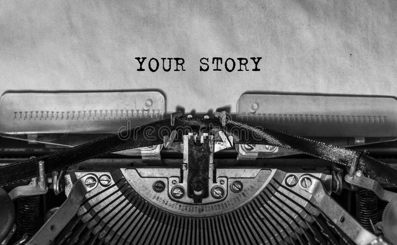 Your story typed words on a Vintage Typewriter. Mechanisms closeup. Typing on old typewriter stock image