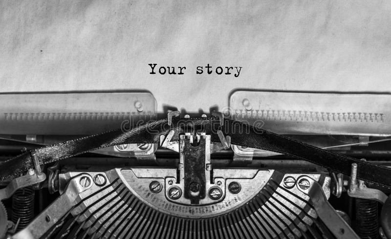 Your story typed words on a Vintage Typewriter. Mechanisms closeup. Typing on old typewriter stock photography