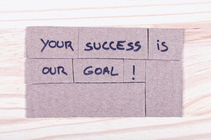 Your success is our goal! written with black felt-tip pen in cut stock image